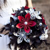 Black, silver and red ornate paper bridal bouquet with shimmering patterned paper and feathers